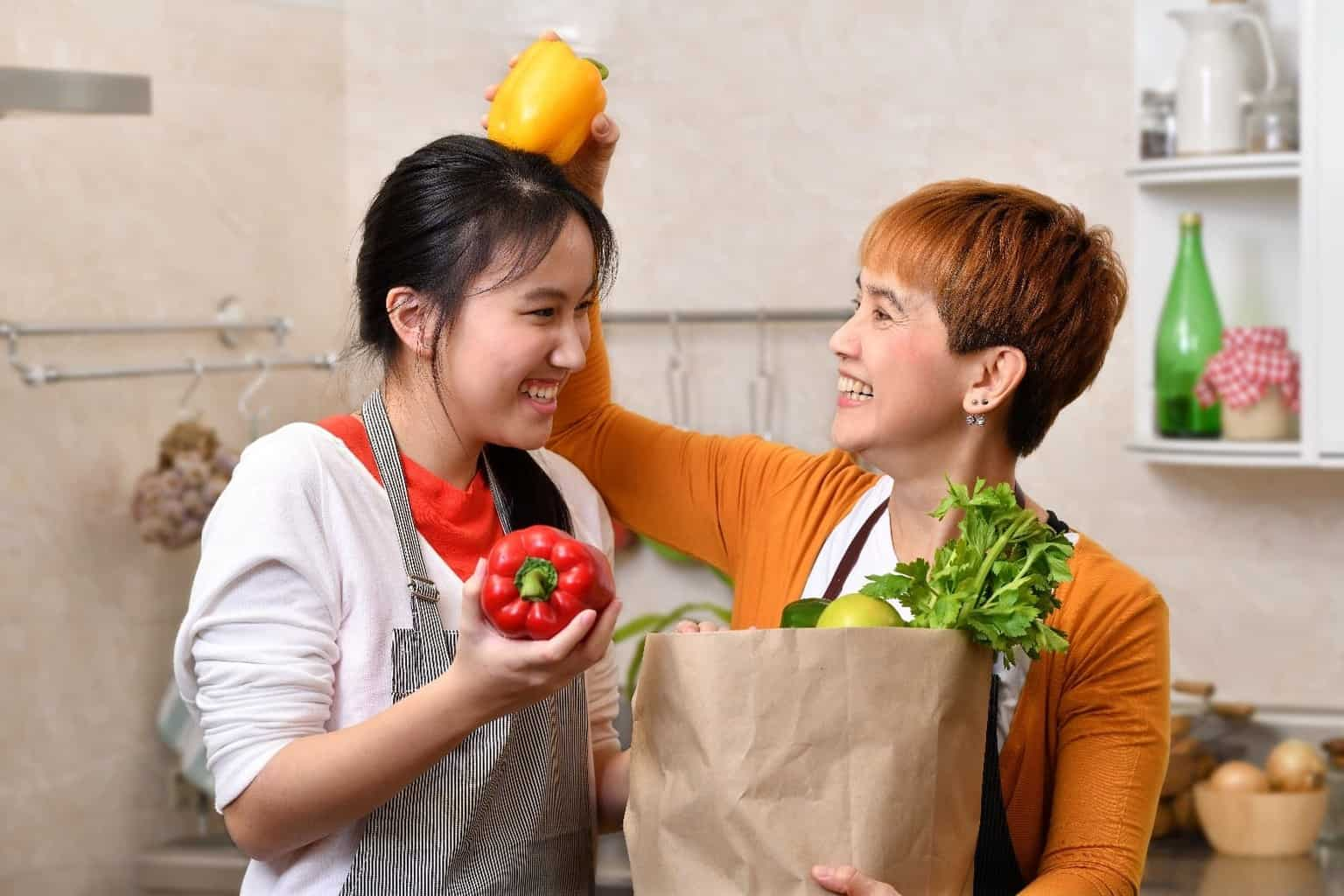 two ladies with grocery bag